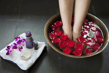 photodune-8872333-womans-feet-soaking-in-water-with-rose-petals-s