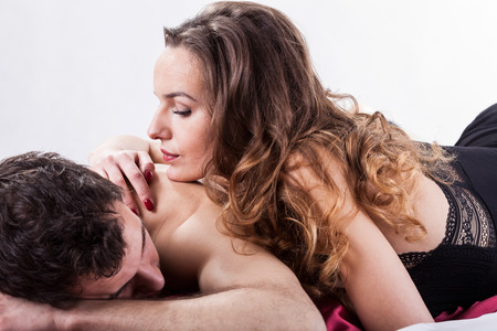 28566010 - erotic moments in bedroom on isolated background