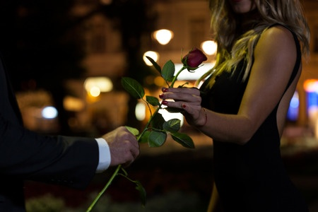 31174880 - woman getting rose on the first date