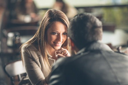 36918328 - romantic young couple dating and flirting at the bar, staring at each other's eyes