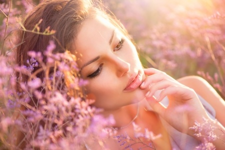 21289469 - beauty girl lying on a meadow with violet flowers