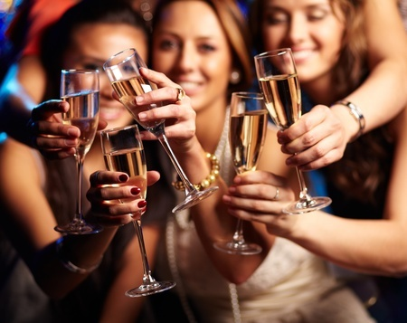 31375809 - group of partying girls clinking flutes with sparkling wine