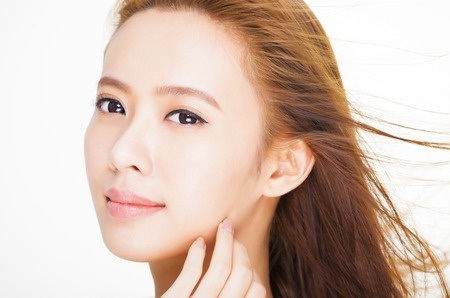 32884133 - beautiful young woman face with hair motion . skin care and hair salon concept.
