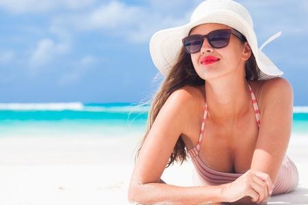 35915096 - long haired girl in bikini and straw hat on tropical caribbean beach