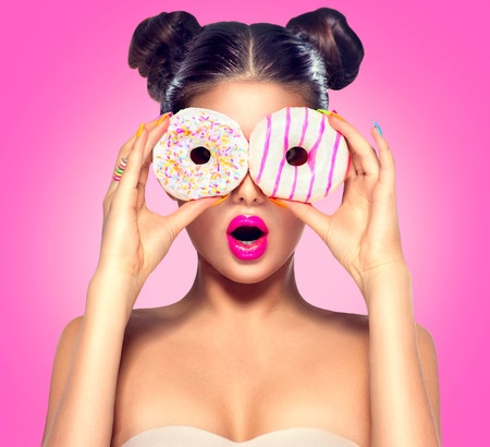 36897620 - beauty model girl taking colorful donuts. dieting concept