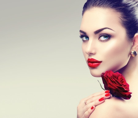 51892338 - beauty fashion model woman face. portrait with red rose flower