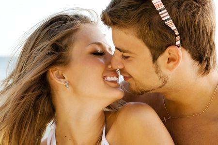 5966105 - romantic couple having fun on the seaside