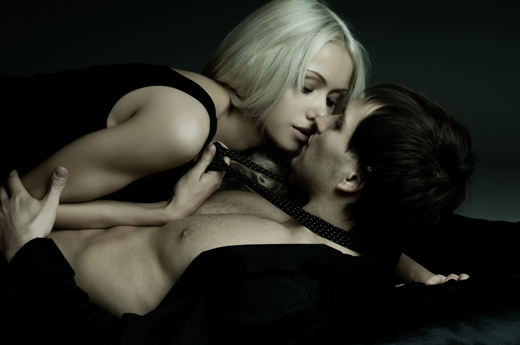 9209489 - muscular handsome sexy guy with pretty woman, on dark background, glamour  light