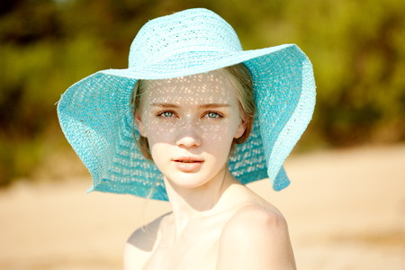 26593220 - beauty portrait of a beautiful woman in hat close-up