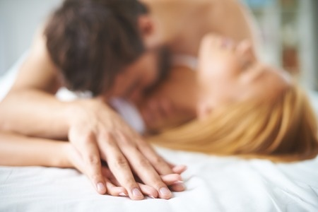 30610090 - hands of female and male lying on bed