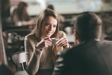 36918333 - young fashionable couple dating at the bar, she is having a coffee