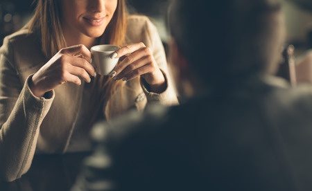 36918472 - young fashionable couple dating at the bar, she is having a coffee