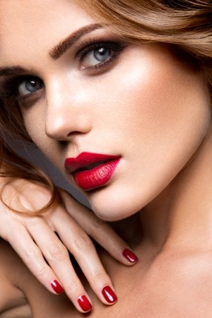 46966276 - close-up portrait of beautiful woman with bright make-up and red lips