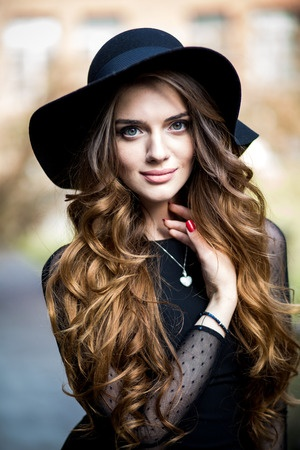 47209275 - beautiful stylish young woman (girl) in dress and hat