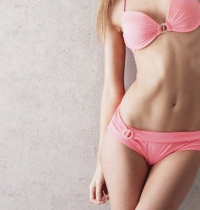 bm_sexy-body-of-a-young-and-beautiful-woman-in-a-pink-swimsuit_55940138