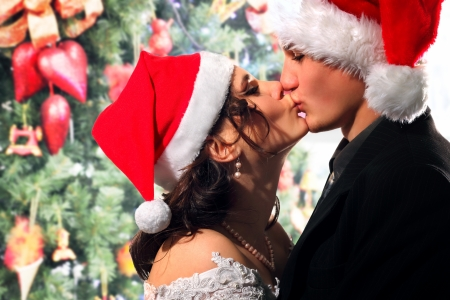10131653 - bride and groom happy kissing christmas young