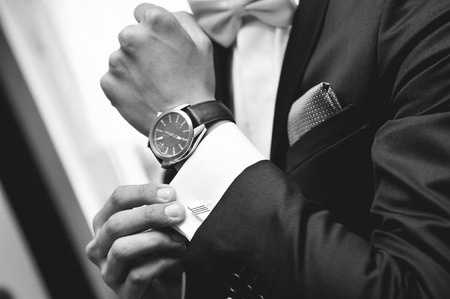 26729597 - man with suit and watch on hand