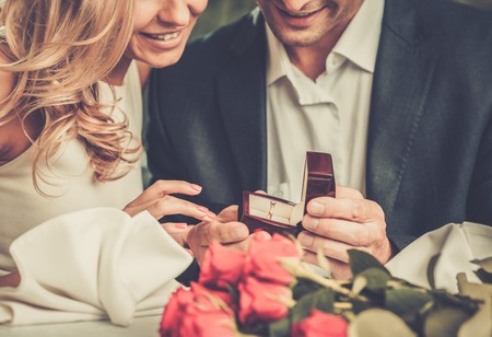 29540088 - man holding box with ring making propose to his girlfriend