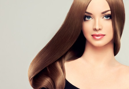 43817271 - girl model beauty with shiny long brown straight hair