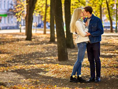 47419270 - young couple hugging and flirting in  park.  full height.