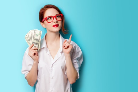 38248023 - portrait of redhead women in red glasses with money on blue background