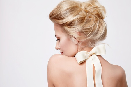 41844701 - tender fashion portrait of beautiful gentle young blond woman with silk bow on the neck cosmetics for body face hair pure natural beauty, organic and diet harmony, makeup
