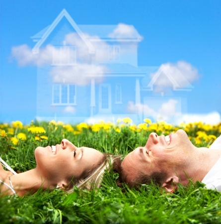 4808161 - young love couple smiling dreaming about a new home. real estate concept
