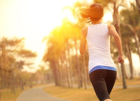 51285375 - woman running at tropical park