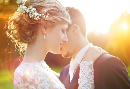 35406586 - young wedding couple enjoying romantic moments outside on a summer meadow